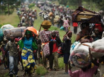 To escape fighting, thousands of civilians flee the town of Sake in the eastern part of the Democratic Republic of the Congo on Thursday. Rebels captured Sake and made other advances in the area this week.